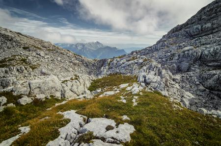 Alpine landscape. View to Krn mountain from Kanin, Slovenia. Untouched wild nature 免版税图像