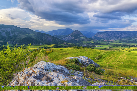 Colorful alpine landscape with green valley, mountains and cloudy skies. Provence, France