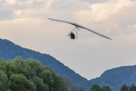 2018-06-30 Tolmin, Slovenia. Hang glider pilot approaches landing. Popular destination for extreme sports in Europe
