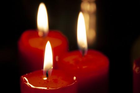Candle lightsin the dark. Loving memory Stock Photo