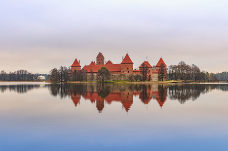 Trakai castle on the lake. Beautiful scene with fortress reflection on water in Lithuania, Europe