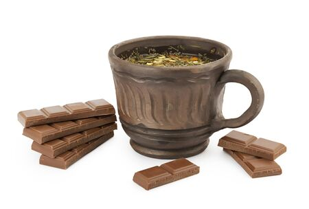 Fresh herbal tea and chocolate bars isolated on white with soft shadow
