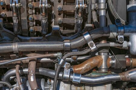 Aircraft jet engine parts. Mechanical background. Tubes, pipes, bolts and nuts assembled as one complicated mechanism