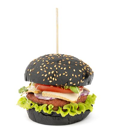 Vegan burger with black bread, tofu cheese and vegetables Imagens