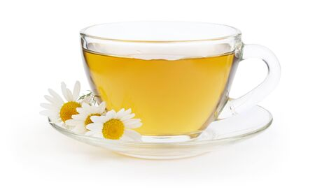 Cup of hot herbal chamomile tea with flowers on white background