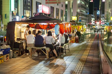 Fukuoka, Japan, May 29, traditional street food in Tenjin district. Fukuoka is famous for its special Yatai mobile street food stalls with local cuisine.