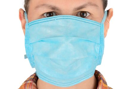 Woman face in medical mask. Protection from virus concept.