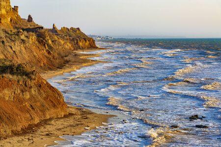 Stormy sea coast. Colorful seaside landscape with sand cliffs and sea waves. Black Sea, Ukraine