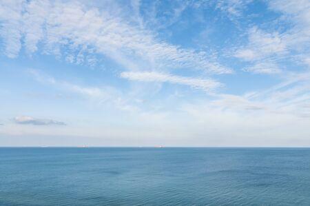 Seaside panorama. Minimalistic background with sea and deep blue sky