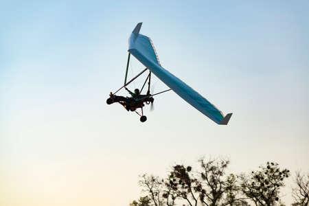Motorized hang glider wing silhouette. Ultralight aircraft Stok Fotoğraf