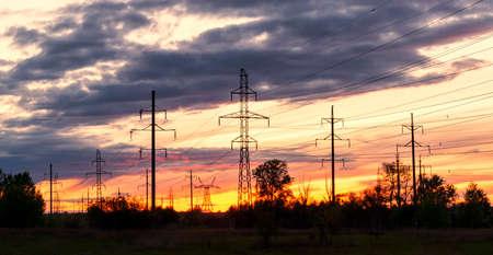 sunset power lines, energy, industrial landscape Standard-Bild