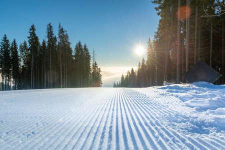 Slopes on ski resort are ready for the winter season. Velvet snow on the ski slope. Stock Photo