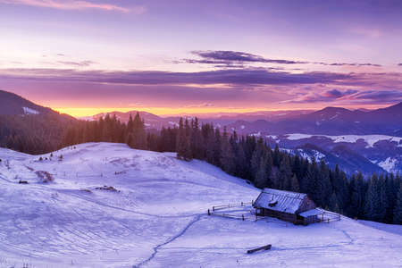 Amazing colors of winter sunrise in the mountains