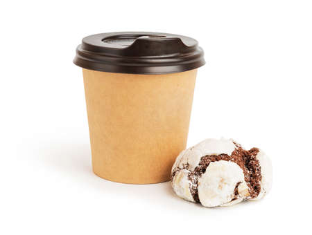 Disposable espresso cup and a brownie cookie on white background