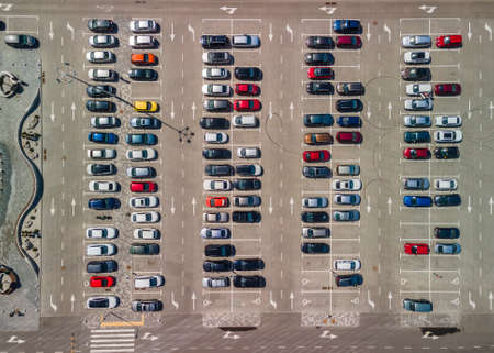 Parking lot from above. Aerial photo of car parking with unrecognizable colorful cars.