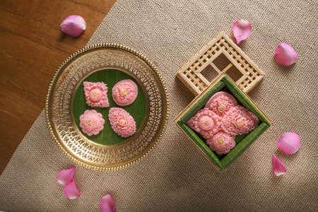 Royal Thai cuisine Thai desserts Pink-gold flowers sweetmeat Famous auspicious desserts for celebration Thai tradition wedding party.