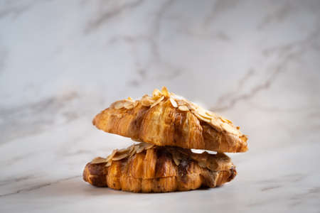 A croissant is a buttery, flaky, viennoiserie pastry of Austrian origin. Croissants are named for crescent shape and are made of a layered yeast-leavened dough called laminating.