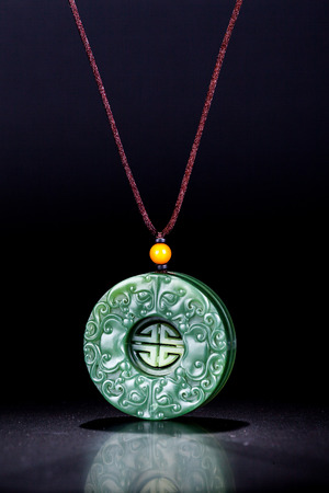 Jade carving necklace pendant Stock Photo