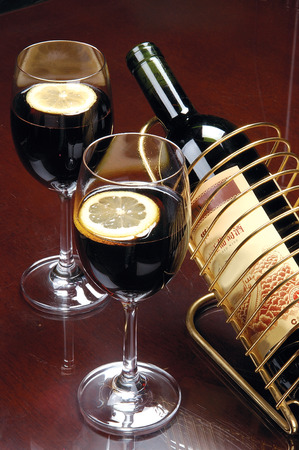 treasured: Two cups of tea with lemon slices of red wine, red wine bottle shelves