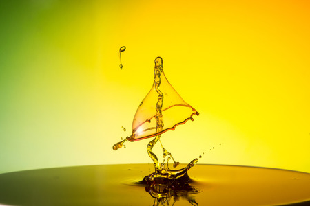 water drop collision on a wet background Stock Photo