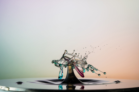 colliding: water drop collision on a wet background Stock Photo