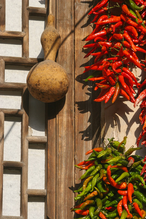 drying: Drying pepper at wooden window