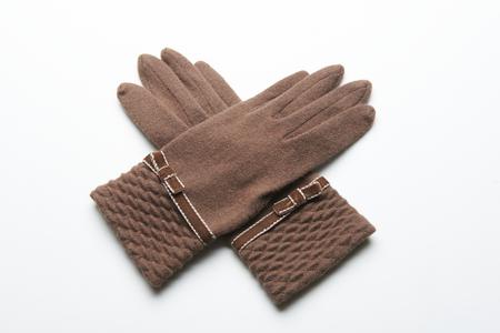 white winter: gloves for winter on white background