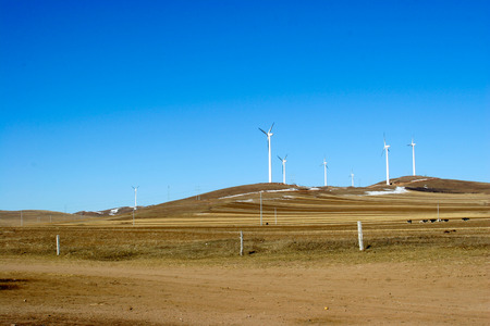 power generator: many wind power generator on grass hills Stock Photo