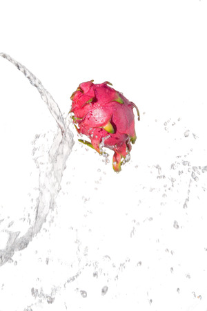 Pitaya under water with a trail of transparent bubbles.