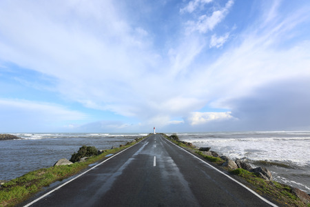 the south island: New Zealands South Island straight road leading to the lighthouse