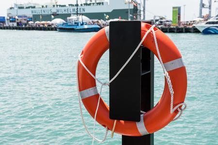 Lifebuoy suspended in port Editorial