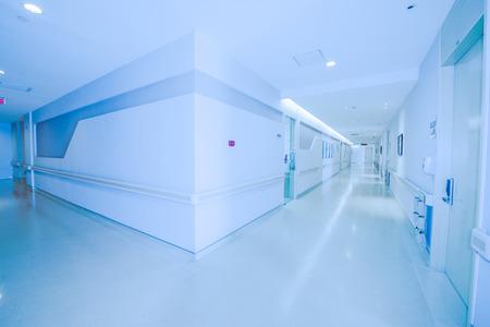 Long hospital hallway, background defocused.