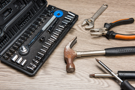 The repair tools is placed on the wooden table. Stock Photo - 66202005