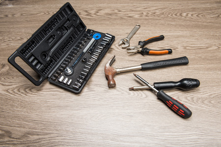 The repair tools is placed on the wooden table. Stock Photo - 66202041