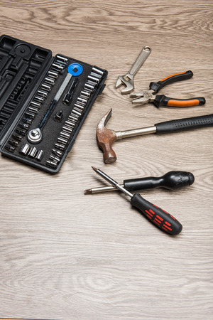 The repair tools is placed on the wooden table. Stock Photo - 66202132