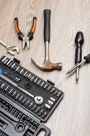 The repair tools is placed on the wooden table. Stock Photo - 66202129