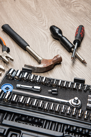 The repair tools is placed on the wooden table. Stock Photo - 66202254