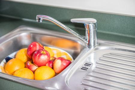 Washing fruits Stock Photo