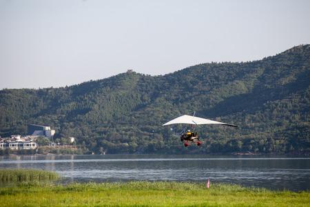 paramotor flying on blue sky