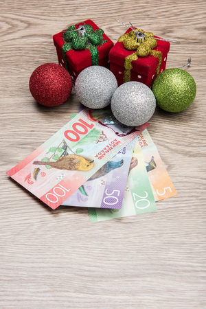 the topics: Christmas decorations and New Zealand Dollar Stock Photo