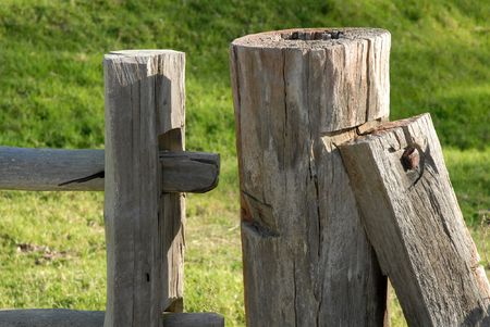 Weathered post and rail farm fence.