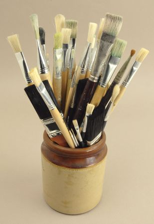 Mix of artists brushes in a jar.