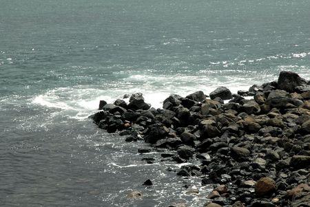 Ocean Breaking On Rocks