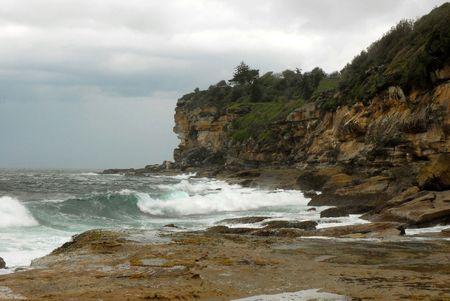 Coastal Headland In Storm