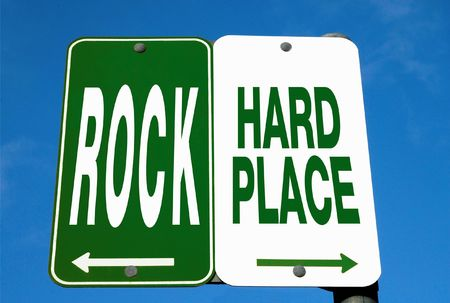hard: Road Sign - Between A Rock And A Hard Place Stock Photo