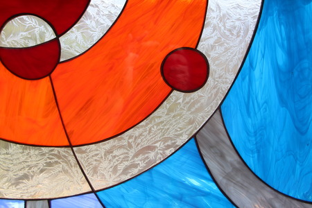 Modern abstract stained glass window made of colored slab glass