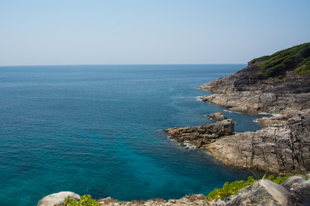 rocky coastline: Rocky Coastline and blue sea on horizontal
