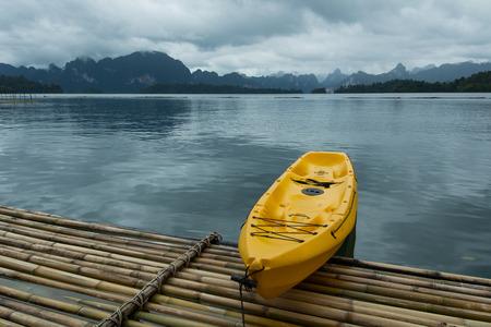 The yellow kayak behind scenery Stock Photo