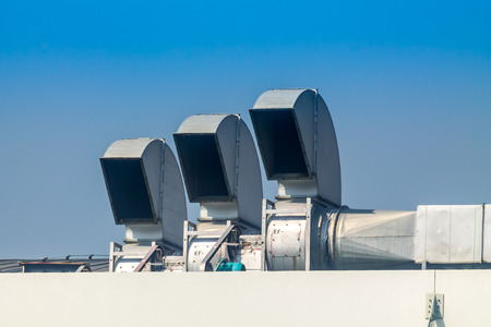 Industrial air conditioning and ventilation systems on a roof,on blue isolated.