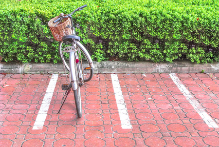 tristesse: Lonely bicycle on a parking lot  Stock Photo